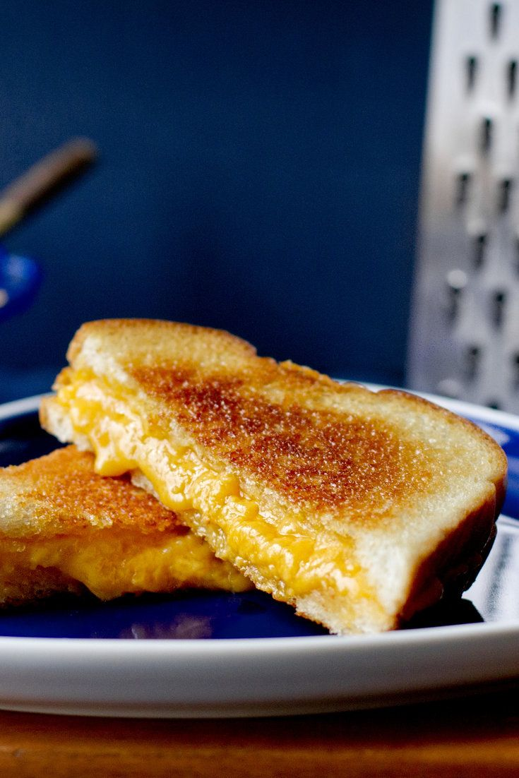 The trick to great grilled cheese sandwiches isn't in the ingredients, but on the stove. Achieving a golden, crusty outside and oozy inside takes a little patience: if the heat is too high, the outside will scorch before the cheese melts. Cooking the slices separately at first gives the cheese a good head start. (Photo:  Rikki Snyder for The New York Times)