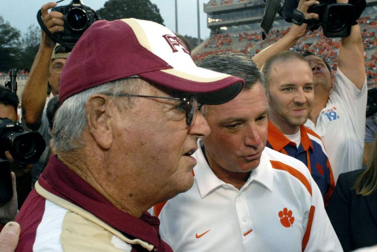 Clemson's head football coach Tommy Bowden, right, joins his father Florida State's head coach Bobby Bowden before the start of their football game (AP Photo/John Byrum)