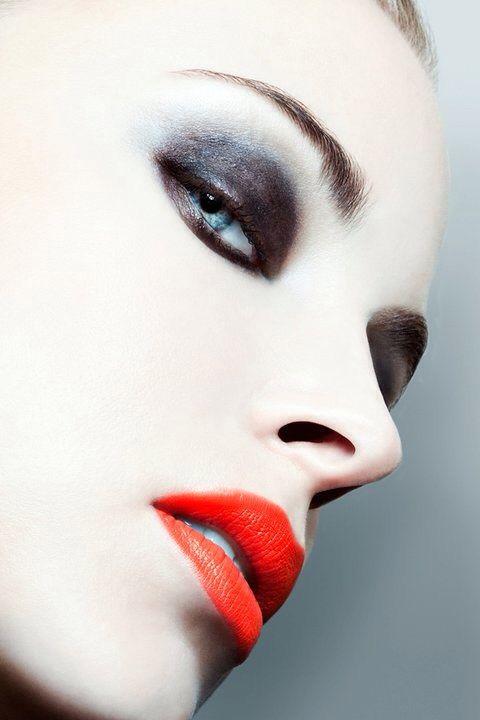 dramatic eyes and tangerine lips