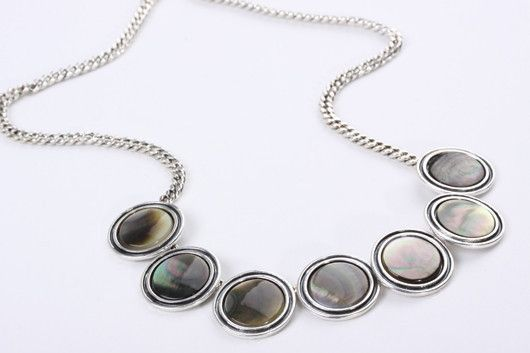 Abalone Disc Pendant Stunning discs of abalone set amid a curb chain, with extension