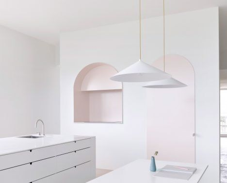 The kitchen inside this Melbourne apartment is designed to look more like a gallery, where furniture and fittings appear as art objects.