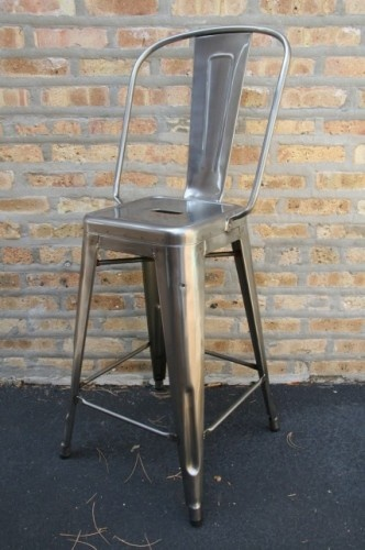 eclectic metal bar stool. Kinda like these and they have a back. Just thinking of my friends who may fall off a stool at my house!