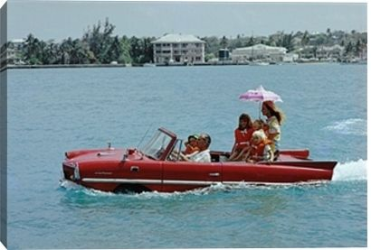 Film producer Kevin McClory takes his wife Bobo Sigrist and their family for a drive in an 'Amphicar' across the harbour at Nassau. The children are Bianca Juarez (Bobo's daughter from another relationship) and Siobhan, Branwell and Saoirse McClory. Original Publication: A Wonderful Time - Slim Aarons (Photo by Slim Aarons/Getty Images)