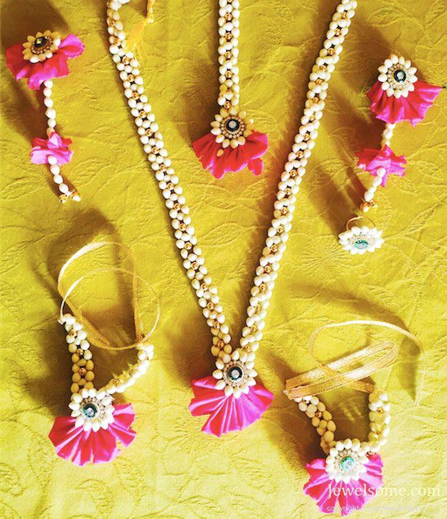 Pink flower jewellery by Pelli Poola Jada