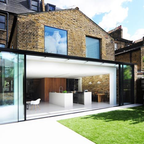 Bureau de Change combines two London houses by punching through original walls and adding an glazed extension and a floating staircase.