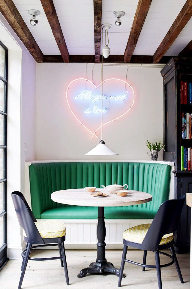 Diner Love.  The table in this photo would look just as good at an all-night diner as it does in the home. The curved teal vinyl bench and the custom-made neon sign complete the diner look.