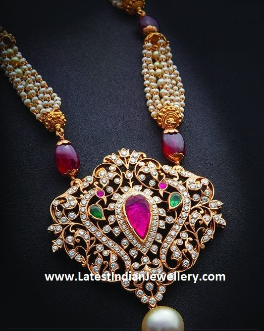 The close setting diamond pendant in peacock design is attached to multi string pearl and ruby beads long chain. The pearls chain can be detached