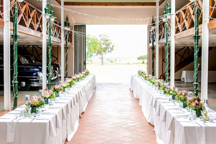 Karoo inspired wedding at Matjiesfontein, with touches of Zimbabwe.Proteas, fynbos, roses, flamelilies, blushing brides, succulents, night sky. Event planner | Wedding planner | Florist | Floral designer | Cape Town