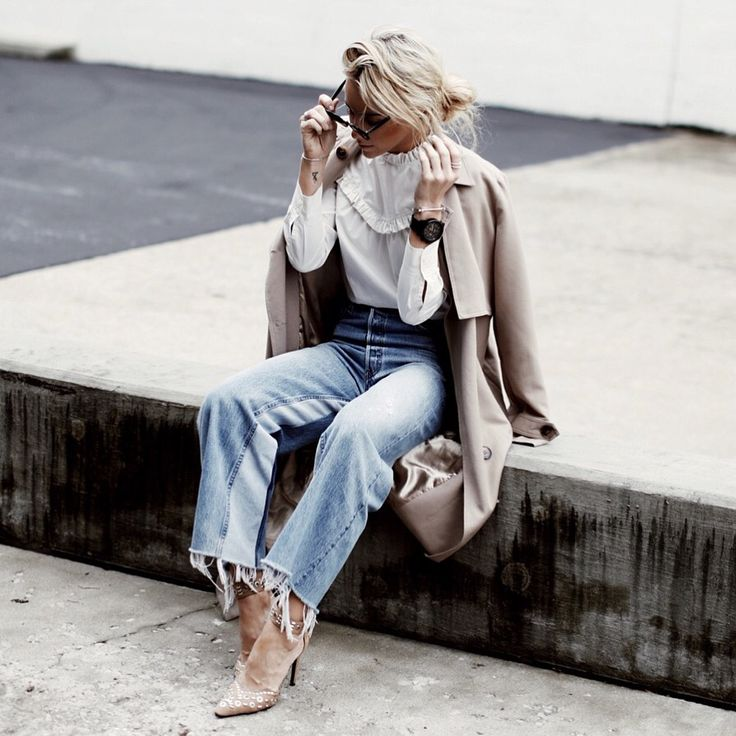 RE/DONE Mary at Happily Grey: wide-legged denim trousers, ruffled white blouse, trenchcoat, heels