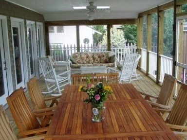 Another good possibility.   Available, 4 bedrooms plus loft, $300/night  Rehoboth Beach house rental - Screened Porch Eating Area