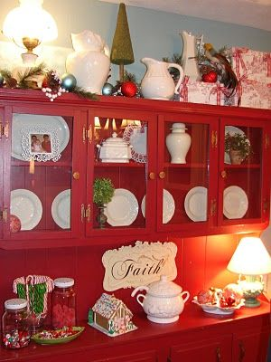 Love this red hutch.....thinking im going to have to get some paint!