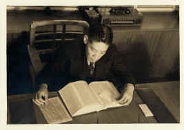 AttorneyY.C. Hong at work at his desk at 445 Ginling Way, LA New Chinatown, Circa: 1938-1940.  Hong was the first Chinese-American to graduate in law from University of Southern California (U.S.C.) and first to pass the bar exam to practice law in California in 1924-1925. Y. C. Hong worked tirelessly to defend Chinese immigration and Chinese American civil rights. America's foremost Chinese attorney, Hong was the son of 19th century immigrants. His father worked in railroad construction.