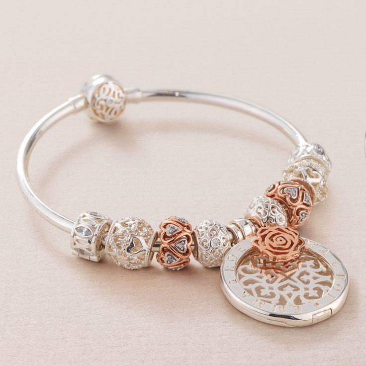 10ct gold, cubic zirconia & sterling silver bangle with charms & interchangeable disc. #elysiancollection #emmaandroe #jewelry #jewellery #pendants #interchangeable