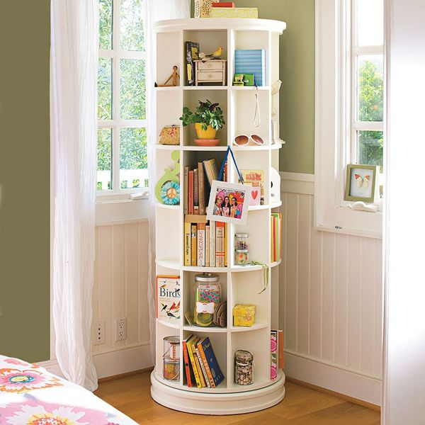 A revolving  book/storage unit.  I can see adding a galley shelf here and there for added texture and functionality.    http://www.pbteen.com/products/revolving-bookcase/