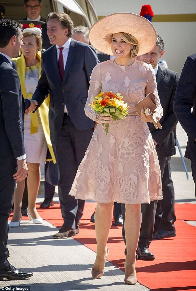 Queen Maxima of the Netherlands dazzled in a pink dress with coordinating shoes, clutch an...