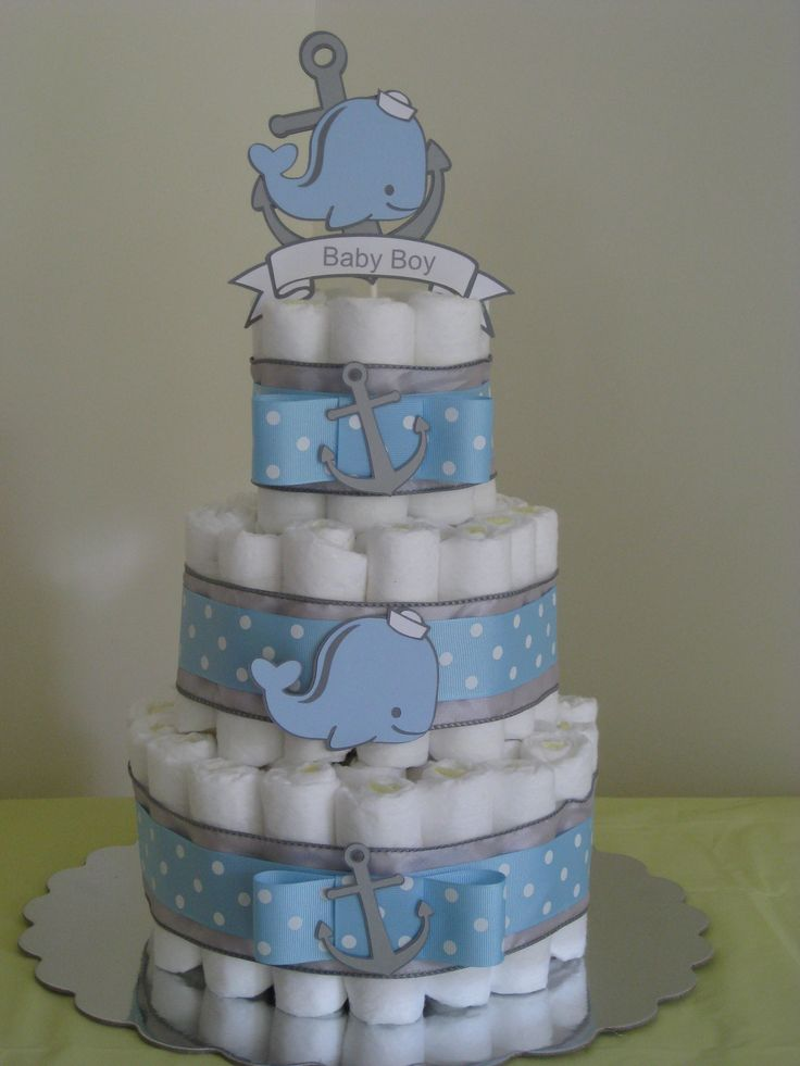 Nautical anchor and whale diaper cake. Hope2create on Etsy where you can purchase diaper cake die cuts for DIY diaper cakes.