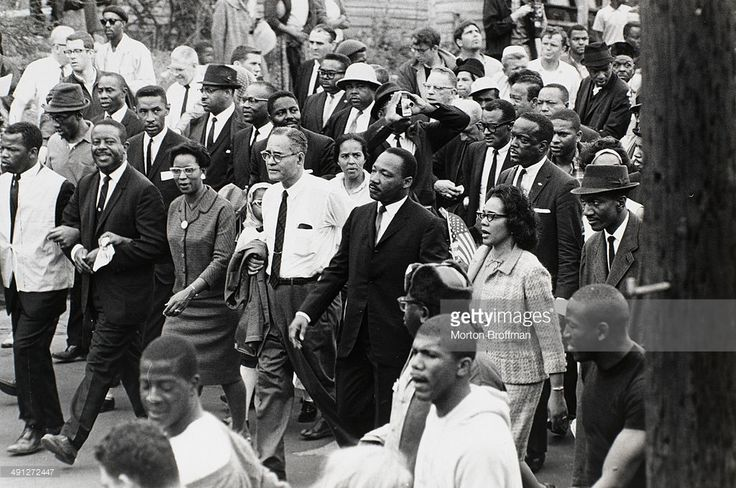 Sixties | Dr. Martin Luther King, Jr. arrives in Montgomery at the culmination of the Selma to Montgomery March, 25th March 1965. Pictured from left are John Lewis, Rev. Ralph Abernathy, Juanita Abernathy, Ralph Bunche, Dr. Martin Luther King, Jr., Coretta Scott King, Rev. Fred Shuttlesworth (wearing hat).