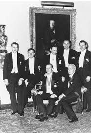 A formal family dinner party at 740 Park Avenue in Manhattan, March 1949. Standing, from left to right: Irving H. Pardee, David, Nelson, Winthrop, and Laurance Rockefeller. Seated: John 3rd and John D. Rockefeller, Jr.