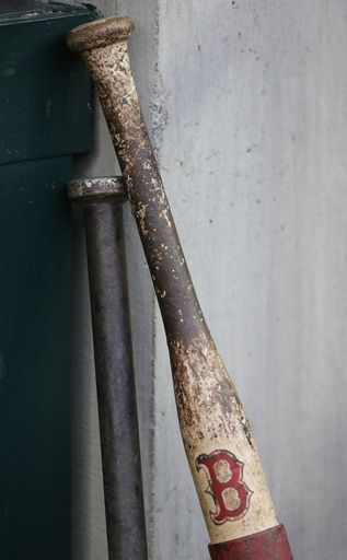 A Boston Red Sox weighted training bat is seen before the start of Game 4 of the American League baseball championship series against the De...