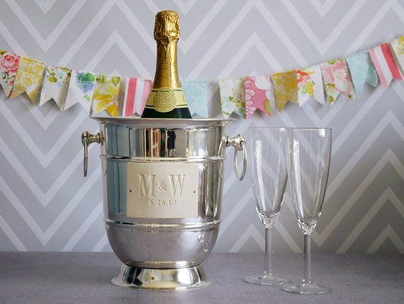 Personalised champagne ice bucket - see more ideas at http://themerrybride.org/2014/09/06/ideas-for-personalising-your-wedding/