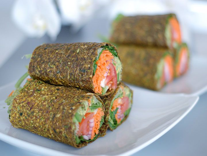 The Global Girl Raw Vegan Recipes: Gluten-free guacamole wraps with tomato, lettuce, bell pepper and red onion in a zucchini, apple and flax seed crust. Use dehydrator