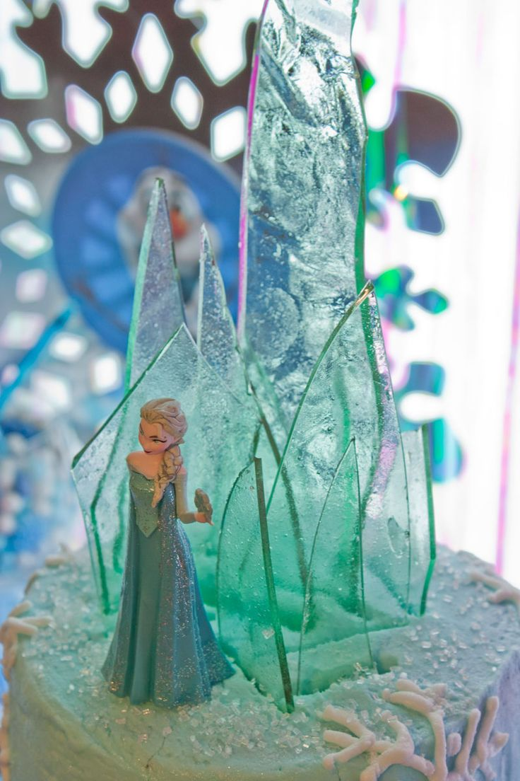 Elsa from Frozen cake complete with hard candy ice wall - tutorial on how to make a Frozen birthday cake with Elsa doll - great birthday cake and birthday party idea