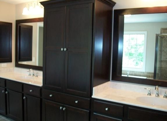 built in linen closet dark espresso cabinets and white counters