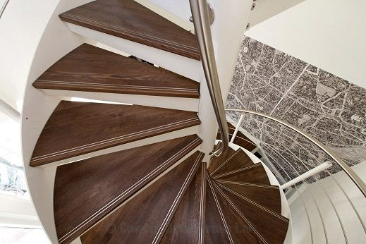 Spiral stair with walnut treads and an external steel stringer