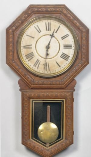 pressed oak octagonal case in original varnish finish with long drop and gilt edged tablet; printed paper dial with Roman numerals marked Made by E.M. Welsh MFG. Co. Forestville Conn. U.S.A. with prin