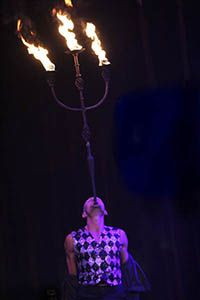 Finhead, aka Captain Finhead, is a world-class combination-stunt performer specialising in object balancing.  From a teaspoon to a ten metre pole and everything in between; axes, feathers, roses, fire tapers, chairs, giant flaming candelabras, swords, and even food, are all part of his repertoire.