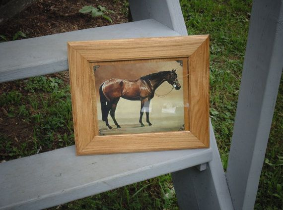 Beautiful solid oak picture frame. This frame measures approximately:  Outside: 11 3/4 x 13 1/2 Inside: 7 7/8 x 9 7/8  This frame is complete