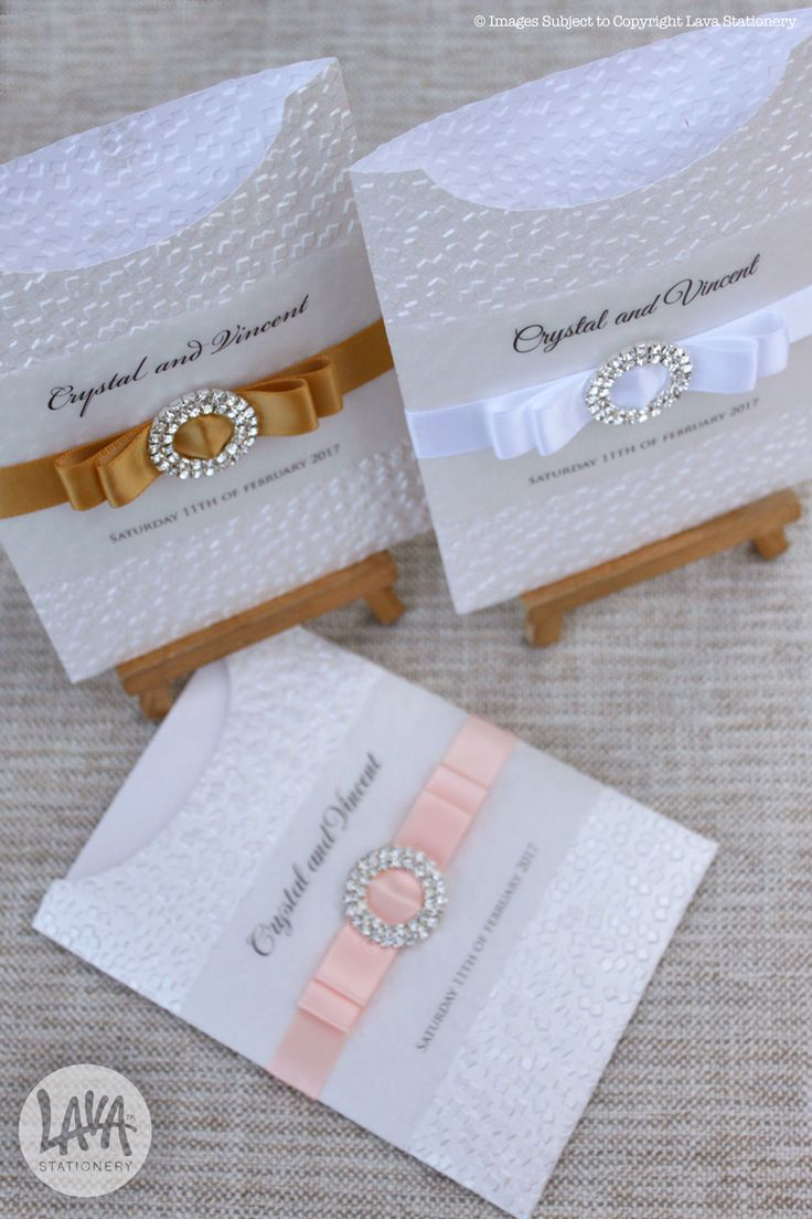 Modina glamour pocket invitations in peach, gold and white satin ribbon with sparkly diamante buckles by www.lavastationery.com.au