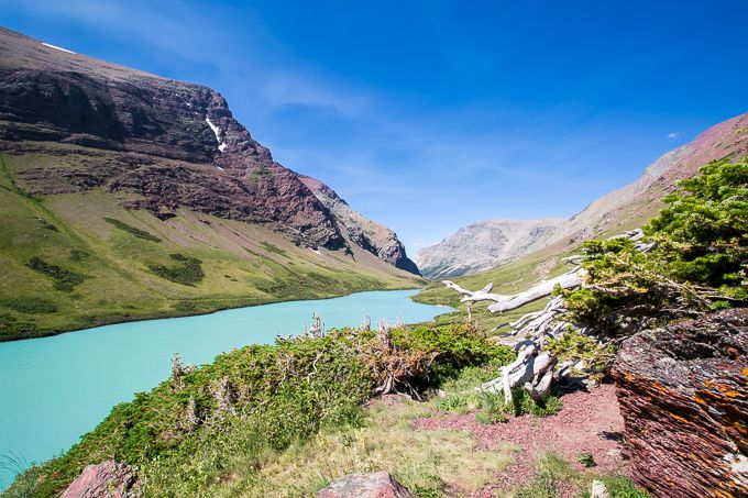 Cracker Lake is located in the Many Glacier region of the park, and it ranks among most people's top 10 hikes to do in Glacier National Park. Many Glacier is probably my favorite section of…