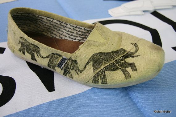 I found this adorable elephant print pair in Matt Butler's Etsy shop. Not only do the elephants match the elephant print lining on some pairs of TOMS, elephants are exceptional animals with amazing memories. What's not to love, I ask? The elephants are hand printed onto the shoe, so each one is unique. Check out Matt's huge collection of hand printed TOMS, with everything from feathers to bicycles.