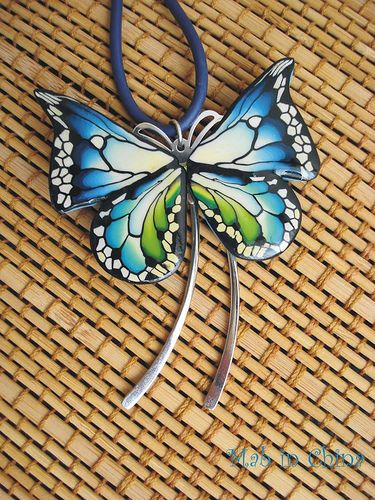 butterfly effect, via Flickr. - pretty butterfly cane clay pendant!!