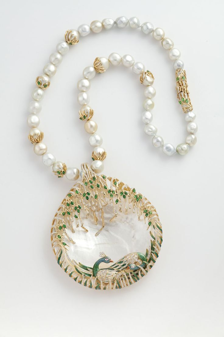 Peacock necklace from Jewels Emporium (celebrity Indian Jewelry designers) with a studded peacock sitting on a mother of pearl along with emeralds, diamonds, pearls and enamel. The peacock is the national bird of India