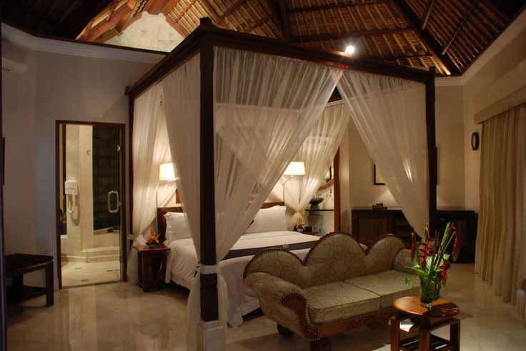 Warm Elegant Bedroom Design With Traditional Wooden Four Poster Bed Curtains And White Duvet Covers Also Wood Carving Sofa And Marble Flooring Ideas: Luxury Viceroy Bali Resort Combine Comfort and Privacy