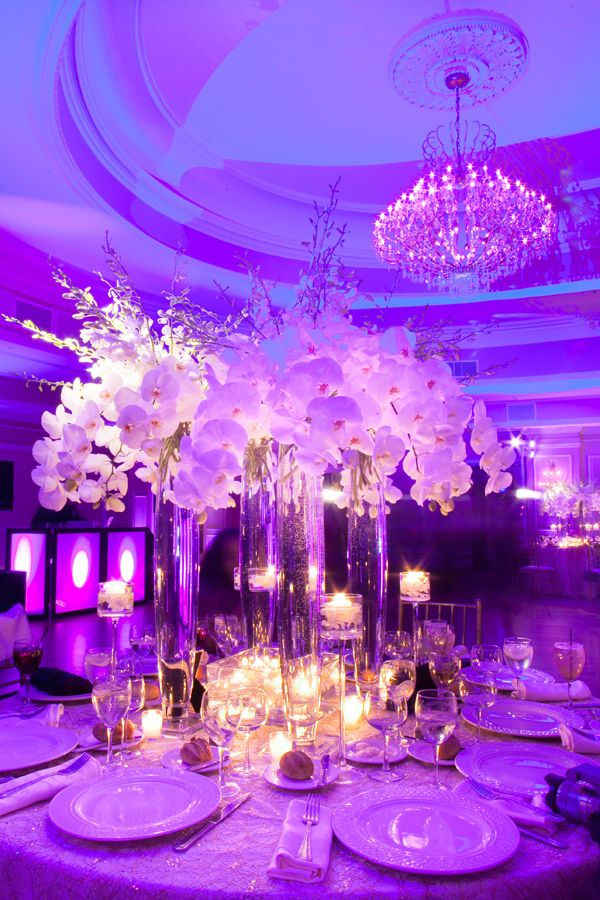 WOW! Fabulous #centerpieces at this #purple, #blue, and #pink #uplighting #wedding #reception in #NewYork! #diy #unique #ideas #inspiration #rentmywedding #fun By #TantawanBloom