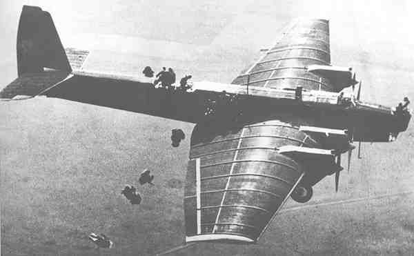 The Tupolev TB-3 was a heavy bomber aircraft which was deployed by the Soviet Air Force in the 1930s and during World War II. It was the world's first cantilever wing four-engine heavy bomber. Note: Airborne troops in picture jumping from wing.
