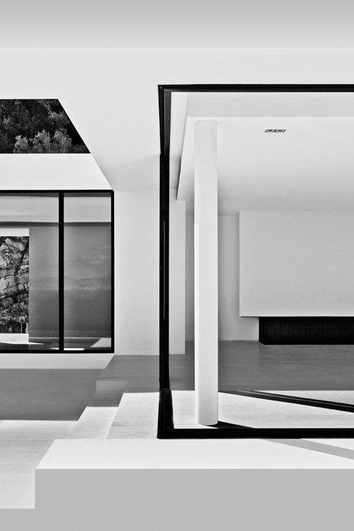 Located along the coastline of Greek Island, Zakynthos, this bright white house designed by Brussels-based architect Olivier Dwek offers amazing views of the Ionian Sea. A game of shadows   #Greece #B&W #Black #white #Photography #Interior #minimal #aesthetics