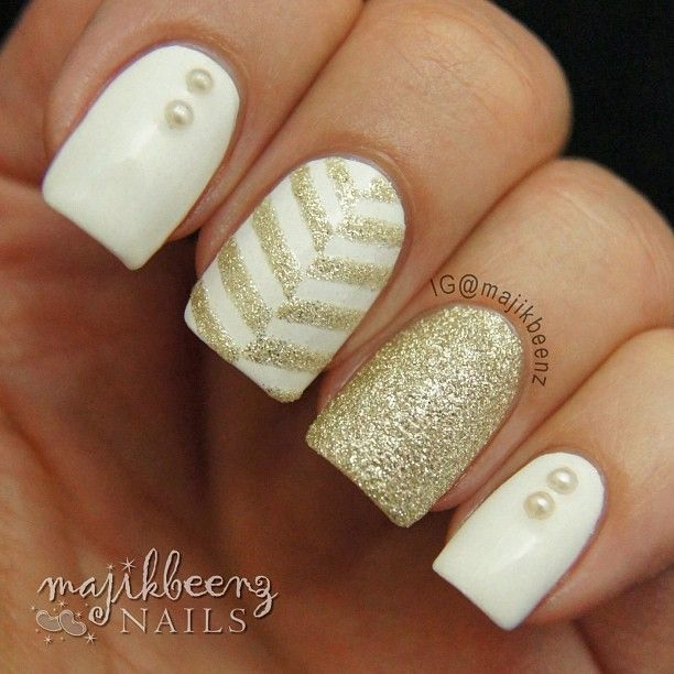 "Nails / Nailart - Gold chevron mani using Julep ""Bunny"" and Zoya Pixie Dust in ""Tomoko"". --- Instagram @majikbeenz"