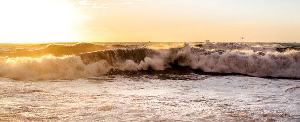 panoramic view of rough sea with sunset light