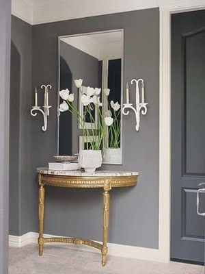 Large mirror over demi lune table. Would be even better with crown molding around the mirror.