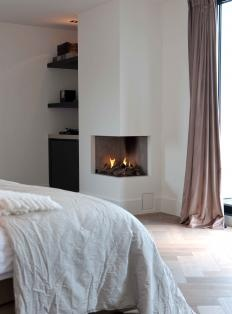 Small fireplace for bedroom, with beverage center tucked away!