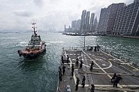 170503-N-ZW825-098   HONG KONG (May 3, 2017) A harbor tugboat transits alongside the Arleigh Burke-class guided-missile destroyer USS Sterett (DDG 104) as the ship departs Hong Kong after a scheduled port visit. Sterett is part of the Sterett-Dewey Surface Action Group and is the third deploying group operating under the command and control construct called 3rd Fleet Forward. (U.S. Navy photo by Mass Communication Specialist 1st Class Byron C. Linder/Released)