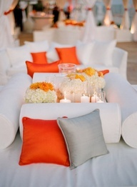 Bold orange pillows brought so much flair to a mellow palette in @Mandy Dewey Seasons Resort the Biltmore Santa Barbara reception cabanas.