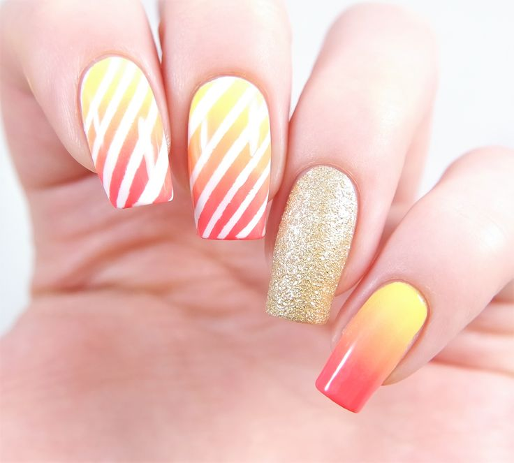 Orange red and yellow sunset ombre stripe manicure using our Gift Wrap Nail Stencils found at snailvinyls.com