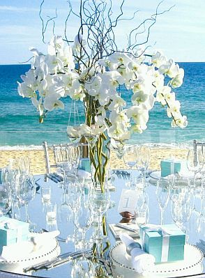 White flower centrepiece with white and blue tones to tie in with the ocean waves