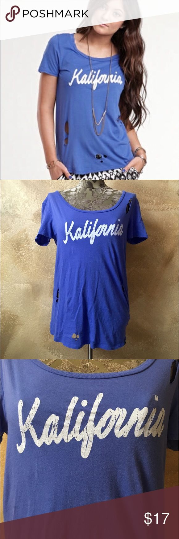 "Kendall & Kylie ""Kalifornia"" Blue Distressed Tee Kendall & Kylie ""Kalifornia"" Blue Distressed Logo Tee   Size: L - True to size  Measurements can be provided upon request 📝  Fabric Content 👗 100% Cotton   Features ✨ •Comfortable, soft, and stretchy  •Distressed holes throughout  •Distressed, scooped neckline + distressed sleeve hems •Cracked ""Kalifornia"" logo front •Blue heart tag on left hip  •Good Used Condition - some pilling throughout   Get 15% off when you buy 3+ items plus save on…"