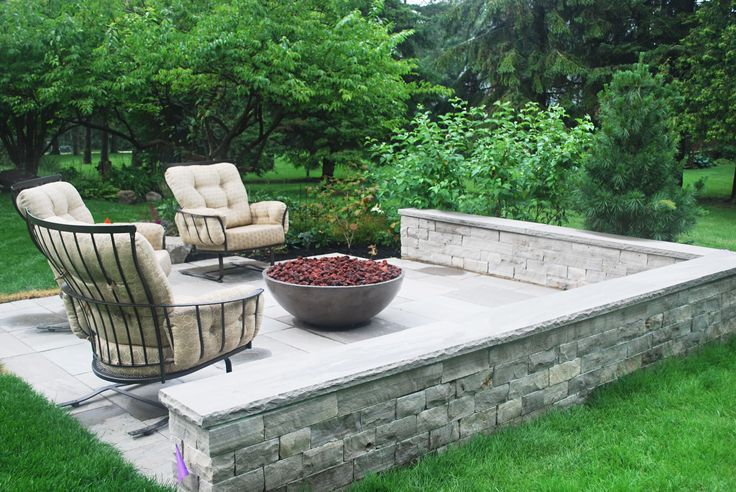 Eramosa stone seat wall surrounding Banas natural stone patio for fire pit area